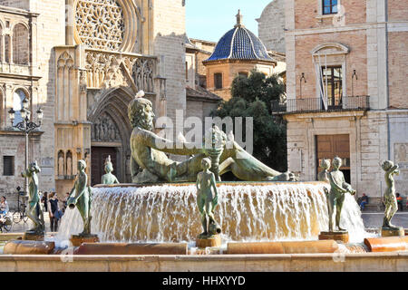 VALENCIA, SPAIN - APRIL 12, 2013: One of touristic landmarks of Valencia - Turia Fountain on Plaza de la Virgen - Stock Photo