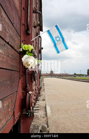 OSWIECIM, POLAND - SEPTEMBER 6, 2012: Israel flag on a deportation train wagon commemorating the victims of nazi - Stock Photo