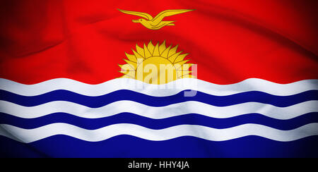 Wavy and rippled national flag of Kiribati background. - Stock Photo