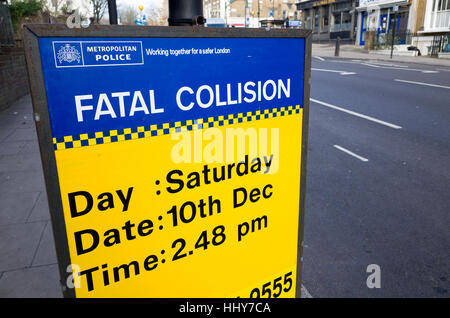 Police Fatal Collision sign beside where a teenager was killed in a road traffic accident, London, England, UK - Stock Photo