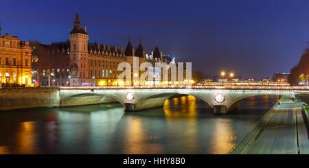 Panorama of Conciergerie at night, Paris, France - Stock Photo