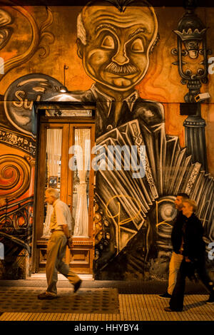 Tango mural painted onto side of building depicting the great maestro Astor Piazzolla, Buenos Aires city. - Stock Photo