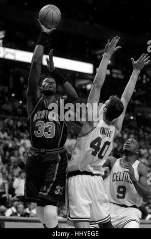 New York Knicks Patrick Ewing scores on Celtics  Travis Knight in the Fleet Center in Boston Ma USA photo by bill - Stock Photo