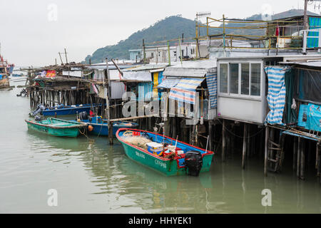 typical houses on stilts in the village of Tai O - Stock Photo