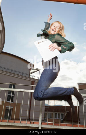 young woman enjoying her lease - Stock Photo