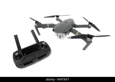 DJI Mavic Pro drone: Latvia JANUARY 20, 2017. Closeup on white background. Drone with remote control. One of the - Stock Photo