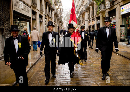 Barcelona, Catalonia, Spain. 21st Jan, 2017. In Barcelona men dressed in traditional costumes walk by the street - Stock Photo