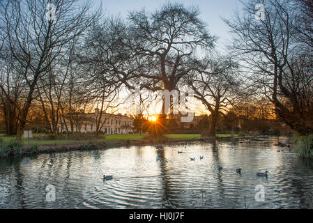 Morden Hall Park, London, UK. 21st January, 2017. Winter sunset on the river Wandle in south London suburban parkland. - Stock Photo