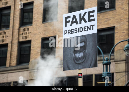 New York, NY, USA. 21st January 2017. Women's March on NYC.  A protester carries a sign that reads 'fake president' - Stock Photo