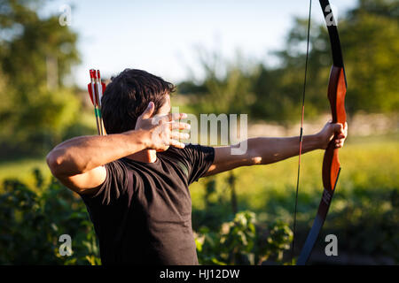 archer, bow, arrow, activity, shoot, danger, spare time, free time, leisure, - Stock Photo