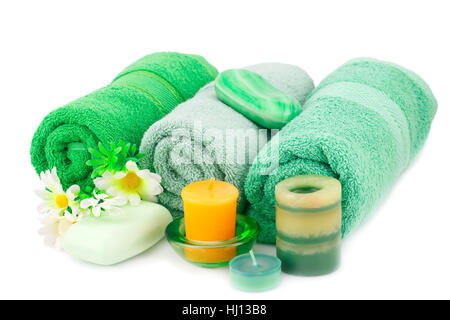 Spa set with towels, soaps, candles and flowers isolated on white background. - Stock Photo
