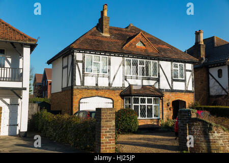 Mock Tudor 1930's house on a sunny day with blue sky / sun / blue skies in Esher, Surrey. UK. - Stock Photo