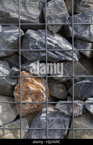Stones behind wire mesh fence Stock Photo: 6080184 - Alamy