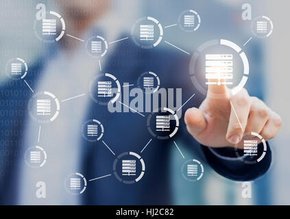 Data and server networks concept with a person touching a digital interface with icons linked together to symbolize - Stock Photo