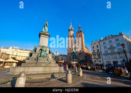 People visit Christmas market at main square in old city - Stock Photo