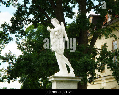 Statue of Apollo in front of Court Theater of Drottningholm Palace, Stockholm, Sweden - Stock Photo