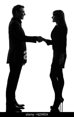 one caucasian couple business woman man handshake in silhouette studio isolated on white background - Stock Photo