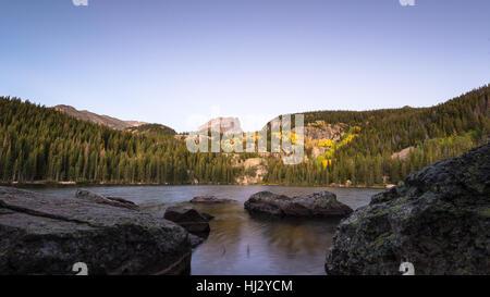 Autumn colors at dawn, underneath Hallett Peak, at Bear Lake, in Rocky Mountain National Park, near Estes Park, - Stock Photo