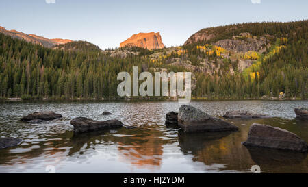 Autumn colors at sunrise underneath Hallett Peak, at Bear Lake, in Rocky Mountain National Park, near Estes Park, - Stock Photo