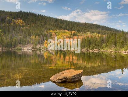 Autumn color reflection at Bear Lake, in Rocky Mountain National Park, near Estes Park, Colorado. - Stock Photo