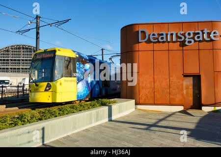 Light Railway System Metrolink tram approaching Deansgate Station in Manchester England. - Stock Photo