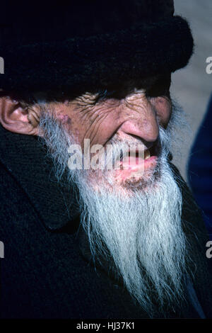 Very Old Centenarian Kyrgyz or Kirghiz Man Wearing traditional Kirghiz Hat Kyrgyzstan or Kyrgyz Republic - Stock Photo