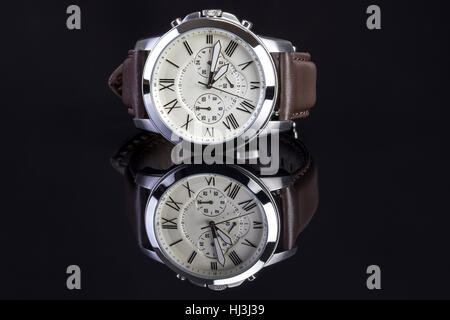 Men's watch with brown leather on black background. - Stock Photo