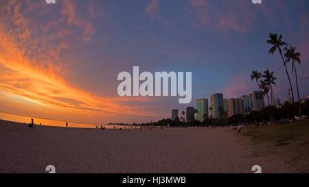 Sunset over Ala Moana Beach, Honolulu, Oahu, Hawaii, USA - Stock Photo