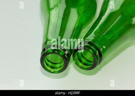 Empty green beer bottle necks on white background - Stock Photo