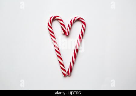 Two Candy Canes Making a Heart - Stock Photo