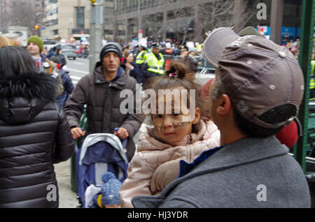 New York, New York, USA- January 21, 2017: Protesters gather for women's march in Manhattan, New York. - Stock Photo