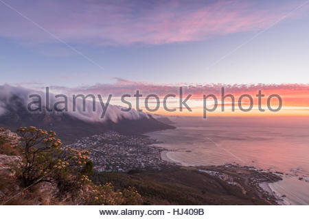 Cape Town sunset from Lion's Head with a blanket of cloud forming a table cloth over Table Mountains Twelve Apostles - Stock Photo