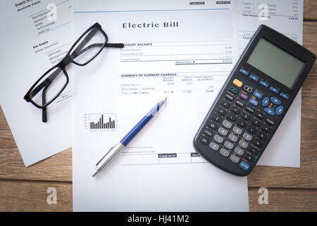 Electricity bill paper form on the table - Stock Photo