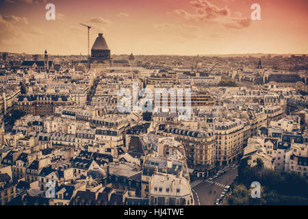View of Paris France rooftops from above at sunset - Stock Photo