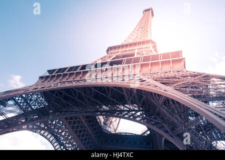 Vintage style image of Eiffel Tower in Paris France with Retro filter effect. - Stock Photo