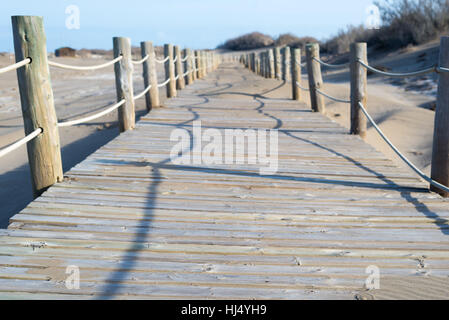 Boardwalk on the beach in an idyllic, peaceful setting, Ebro Delta National Park, province of Tarragona, Catalonia, - Stock Photo