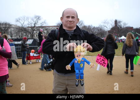 District of Columbia, USA. 21 Jan, 2017. A man wears a mask of Russian President Vladimir Putin and holds a doll - Stock Photo