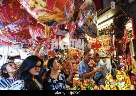 (170122) -- BANGKOK, Jan. 22, 2017 (Xinhua) -- Customers look at decorative items for the upcoming Chinese Lunar - Stock Photo