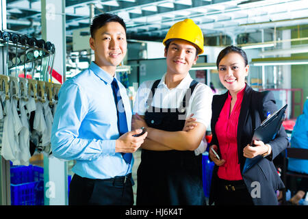 showing the list workersproduction manager and owner in factory stock photo - Fashion Production Manager