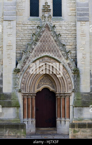 Detail of ornate wooden doors and arches all saints church for Entrance to rivet city