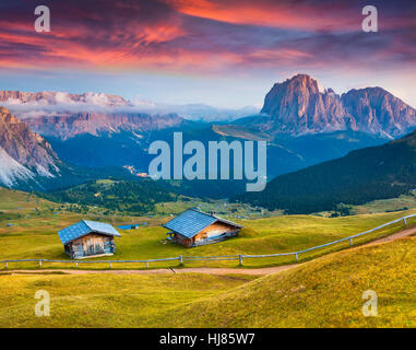 Dramatic sunrise on the Sassolungo (Langkofel) and Sella group, valley Gardena. National Park Dolomites, South Tyrol,Italy - Stock Photo