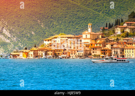 View of the city Peschiera Maraglio, a bright sunny day. Region Lombardy, Province Brescia (BS) in Iseo Lake. Italy, - Stock Photo
