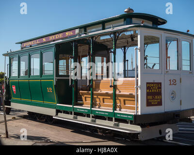 A green cable car in San Francisco's Powell-Hyde line end - Stock Photo
