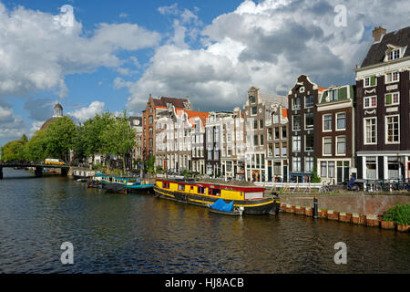 Historic row of houses on the Singel canal, Amsterdam, Holland, The Netherlands - Stock Photo