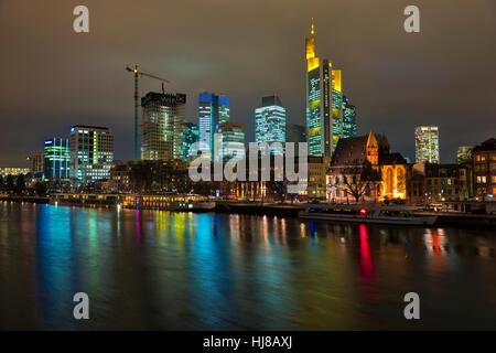 View of skykline from Iron Bridge, Commerzbank Tower, Union Investment Skyscraper, WINX Highrise, night, Frankfurt, - Stock Photo