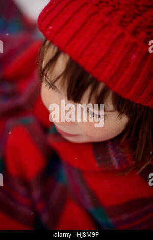 Portrait of  a girl with snowflakes on her nose and eyelashes - Stock Photo