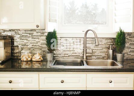 Countertop and sink in modern kitchen - Stock Photo