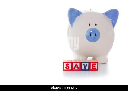 Blocks spelling save in front of blue and white hand painted piggy bank - Stock Photo