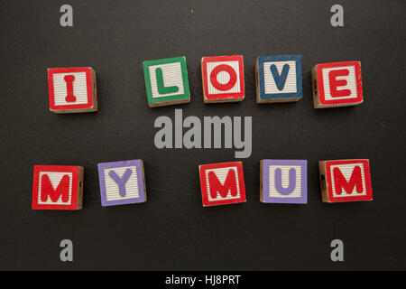 I love my mum message in blocks on chalkboard - Stock Photo