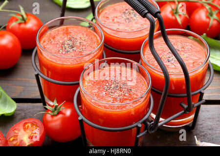 Fresh healthy tomato smoothie juice in metal container on wooden background - Stock Photo